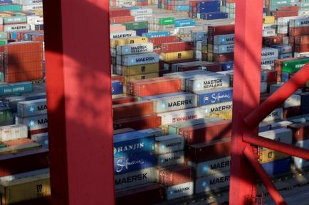Containers are seen at the Yangshan Deep Water Port, part of the Shanghai Free Trade Zone, in Shanghai, China, September 24, 2016. REUTERS/Aly Song/File Photo